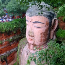 The Giant Buddah's head dwarfs the crowd waiting to see it, almost