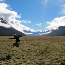 Kim jumping for joy on our way to Milford Sound